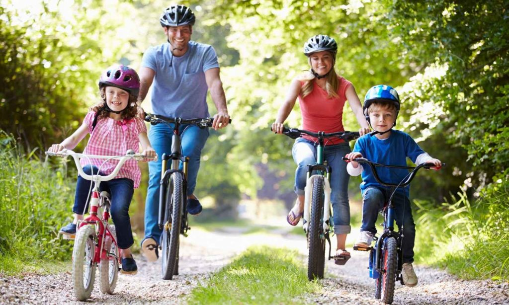 Couple is riding with two kids on BMX Bicyle