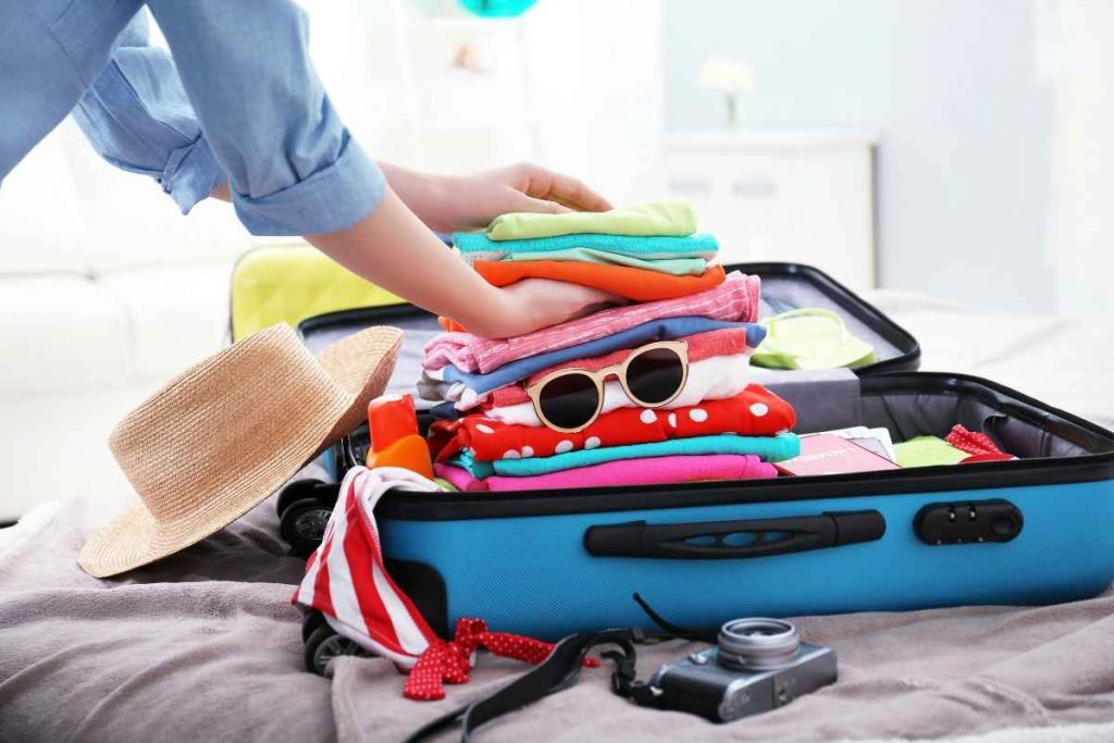 Packing Clothes in Luggage by Pierre Cardin