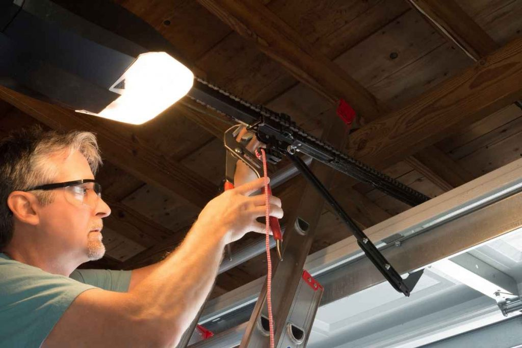 A man fitting the garage door opener