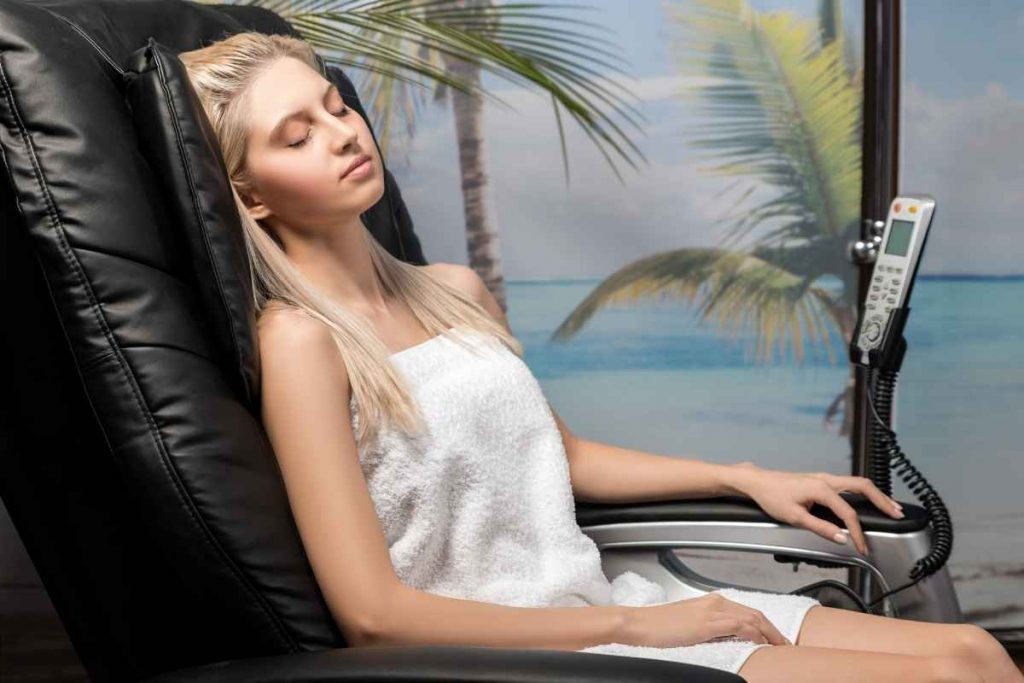 A girl relaxing by sitting in massage chair