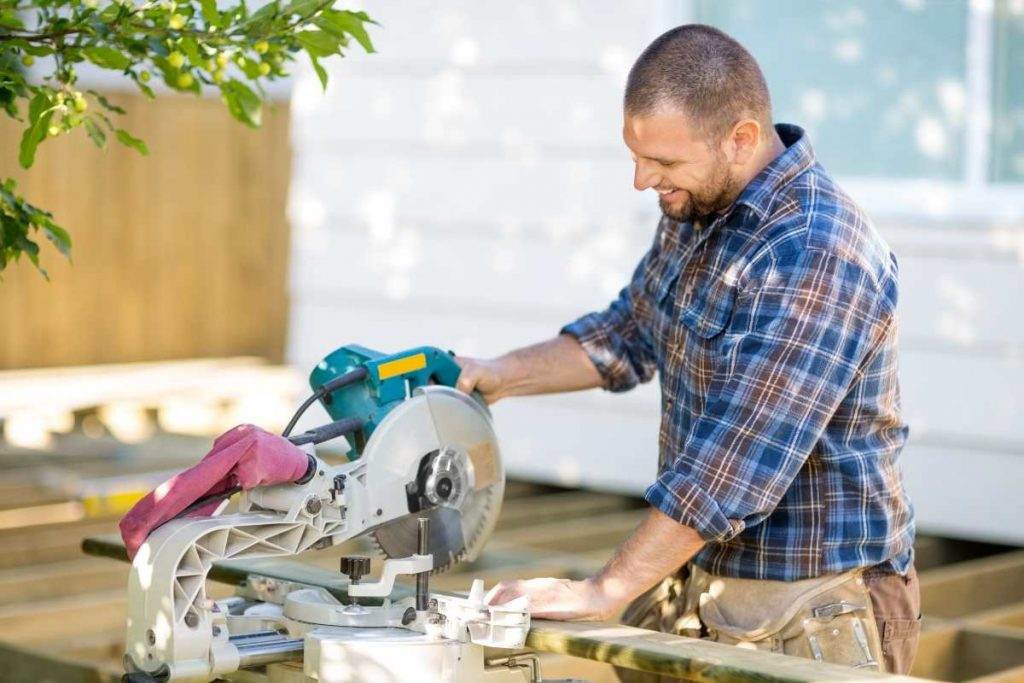 A man working on table saw to cut some wood