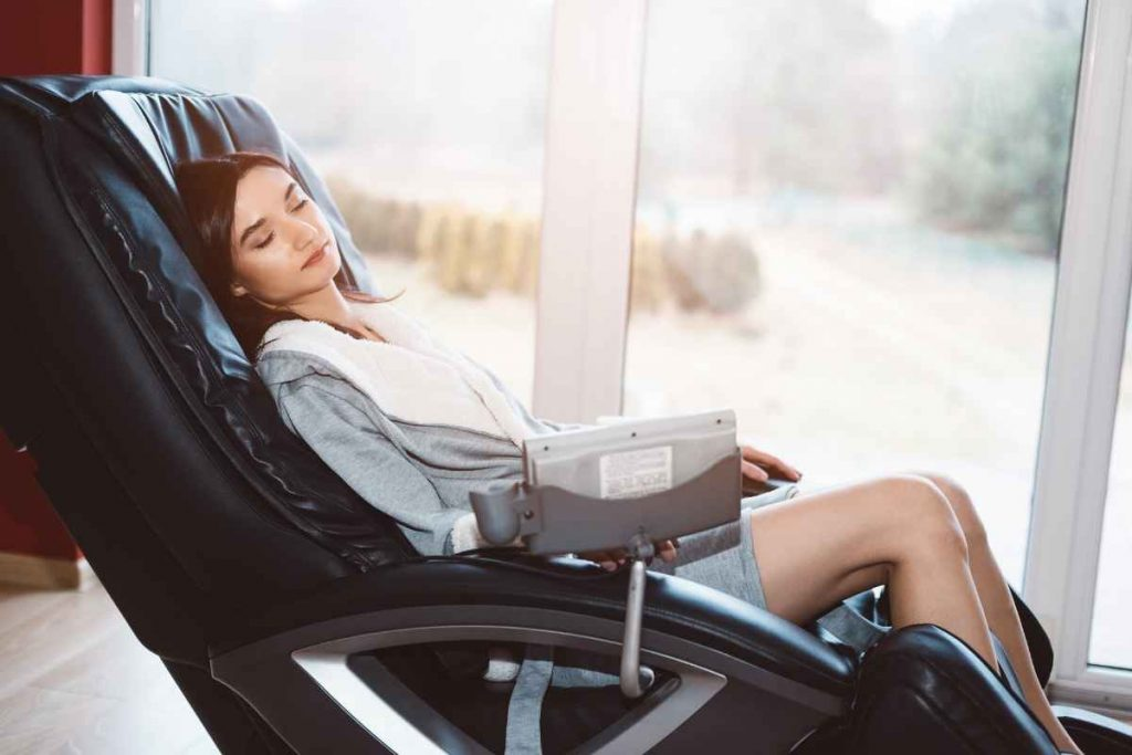 A girl laying with relaxation on a leather sofa chair