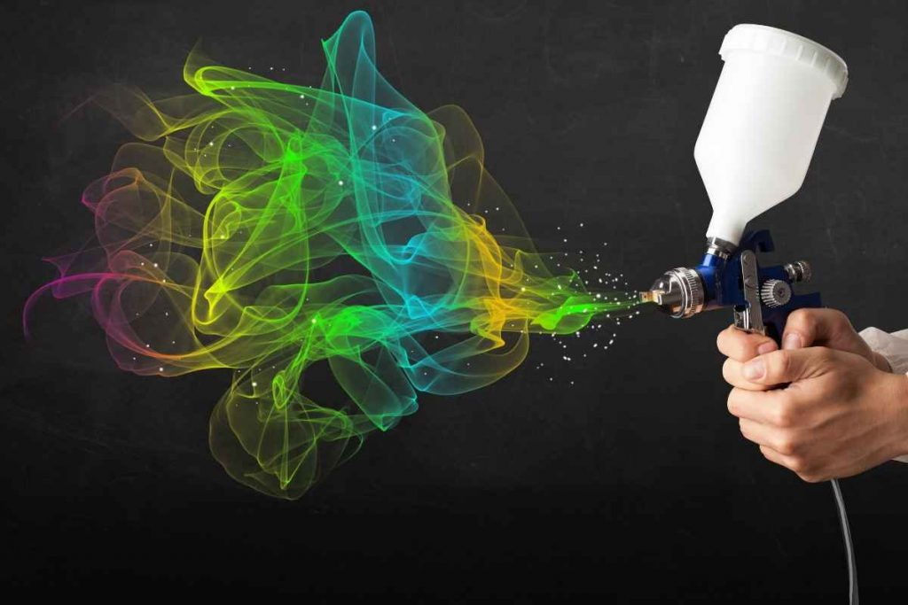 A man hands with animation color spraying with best paint sprayer