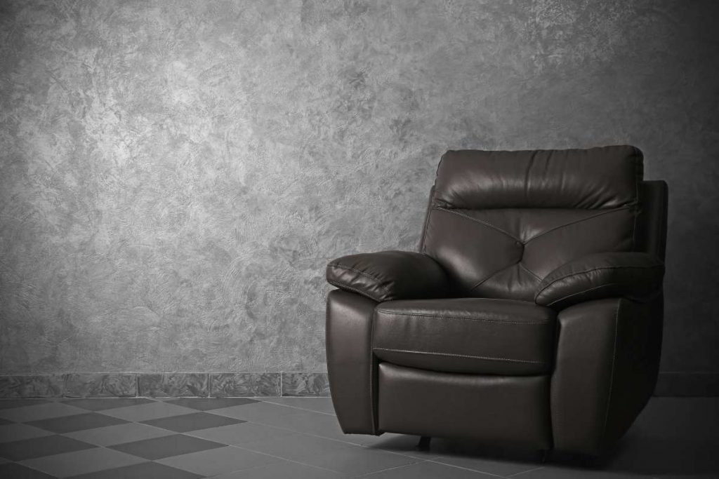 Black Recliner chair in en empty room