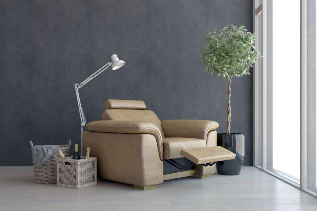 Best Recliner Chairs with light and plastic tree in a room