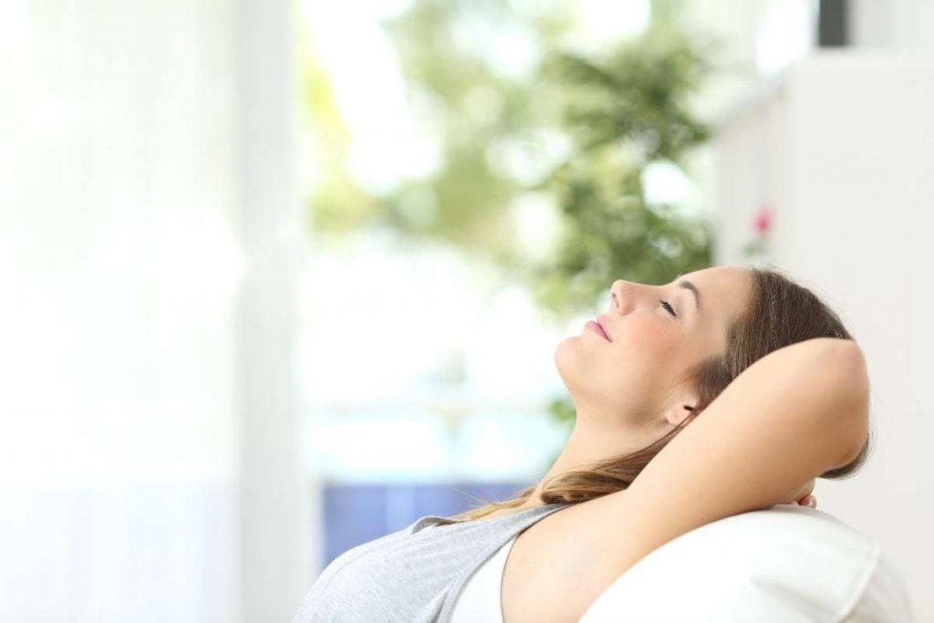 A girl enjoying the fresh air in room