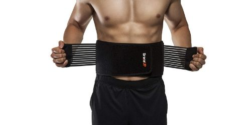 Man Tying the belt around his back
