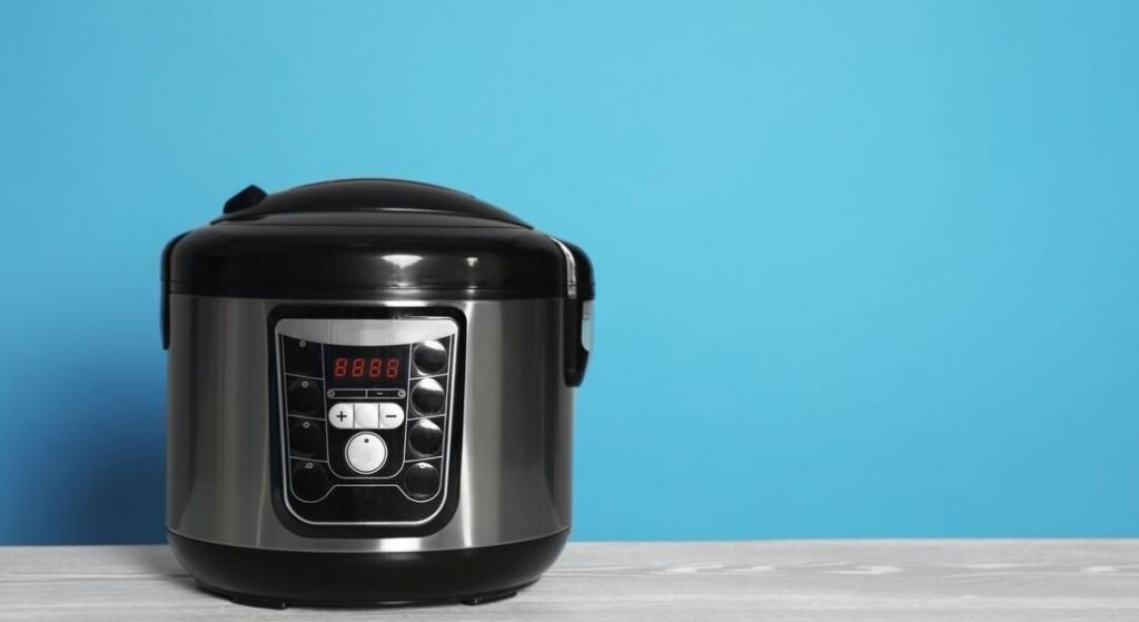 black pressure cooker with blue background