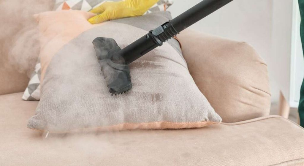 A steam cleaner is cleaning the pillow steam