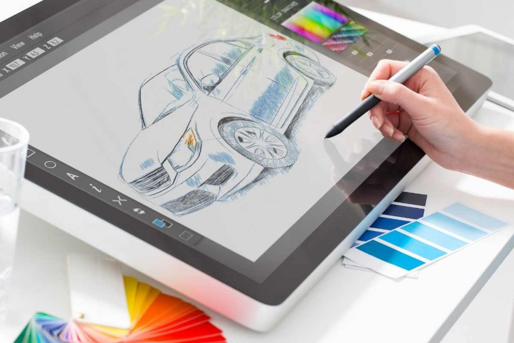 Someone is drawing the car image with drawing tablet