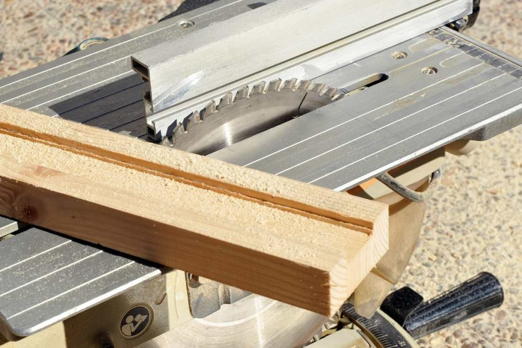 Hybrid table saw with wood