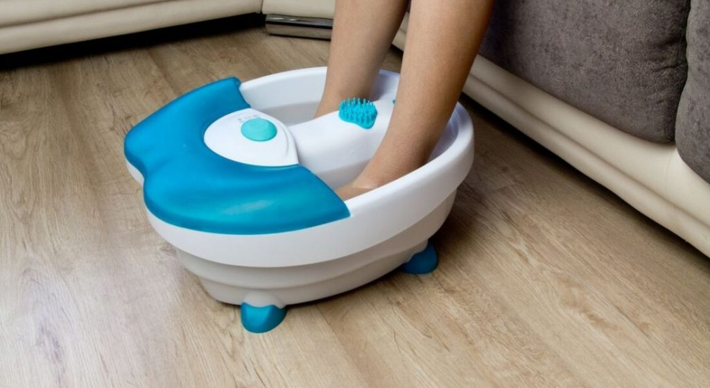 A person using Foot Spa for massage